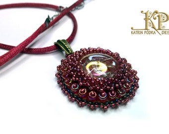Elegant bead embroidered pendant with cracked glass cabochon
