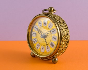 Vintage travel alarm clock in a French rococo style by Talgo of West Germany