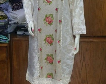 Beige and Gold Tunic with pink and green motifs.