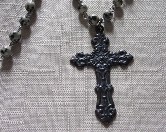Rosary style necklace with cross