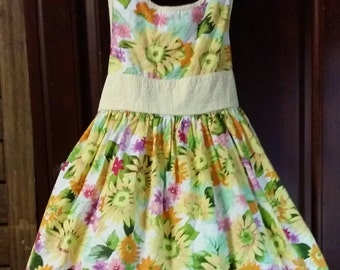 Little girl basic yellow/ green  vintage dress, with multi colorful flowers.   By Polly & Friends,