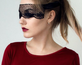 Black lace guipure eye mask with black ribbon for covering the eyes