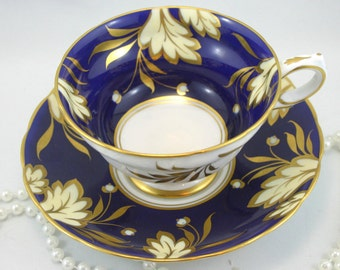 Gorgeous, Grosvenor Teacup & Saucer, Cobalt Blue Borders Nicely Decorated with Golden Leafs, Gold Rims, Bone China made in England in 1960s.