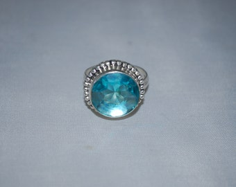 Sterling silver ring size 8 with blue synthetic stone.
