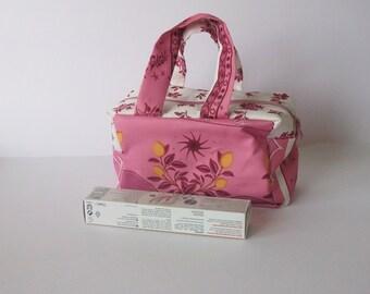 Pink and white Sponge bag for women.