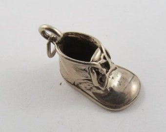 A Baby Bootie Sterling Silver Charm.