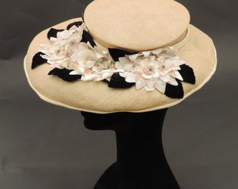Straw wide-brimmed hat and flowers ' 40