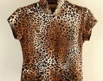 Vintage brown animal print shortsleeve top.size m
