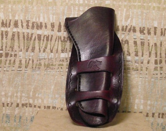 Right Hand 45 Colt Frontier Holster in Mahagoney. Hand stitched leather with tooling.