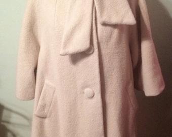 Lilli Ann Cream Swing Coat with knot collar