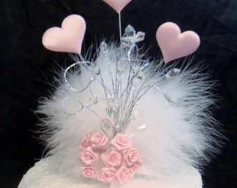 a  pink satin heart ribbon roses  crystal feather wedding birthday cake topper