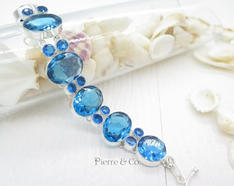 Oval Cut Swiss Blue Topaz Sterling Silver Bracelet