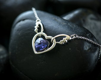 Tanzanite Angel's Heart Necklace - Featuring a heart shapmed Swarovski Crystal set in a Rhodium finish