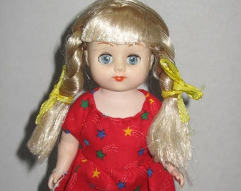 Kayla, 7 inch doll dressed in handmade dress, comes with stand