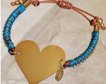 Precious leather bracelet with blue thread