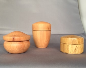 """Three Robinia wood boxes approximately 2""""[5cms] diameter and 1.1/2"""" [4cms] deep. Tallest one is 3"""" [7.5 cms] deep"""