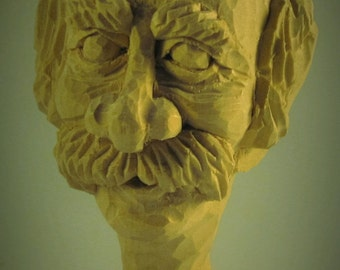 Wood carving head of old guy caricature