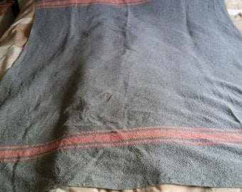 grey/blue army blanket with zam/pink stripes. Vintage from the 70s.
