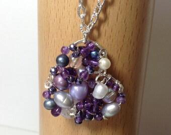 A heart shaped multi- gem pendant necklace