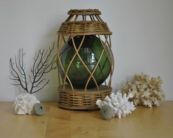 Old wicker and glass fishing float