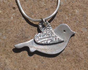Fine Silver paisley heart winged bird necklace.