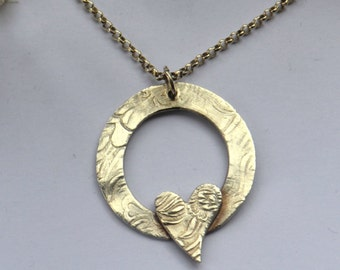 Vintage style handmade fine silver love heart necklace.