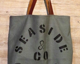 Dark green canvas bag with handmade ...