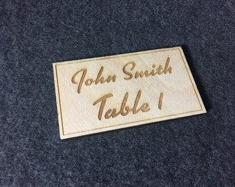 Wedding table name cards engraved in wood
