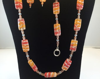 Lampwork glass beads, red, orange and white