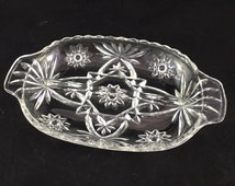 Pressed glass divided condiment dish, candy dish, relish dish, vanity dish with star pattern and handles