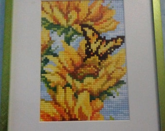 Framed pixel mosaic butterfly and flowers