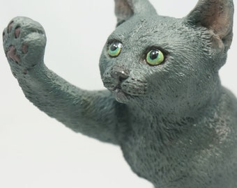 Consensus(Russian Blue cat figurine)