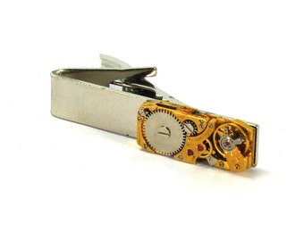 Sleek Steampunk Tie Bar Clip with Vintage Antique Watch Movement Ruby Gemstone Jewelry Gold Toned Rectangular Rectangle