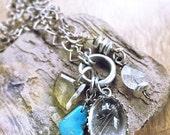 Sun kissed golden needled rare rutilated quartz and sleeping beauty turquoise pendant