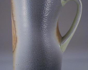 Side fired stein