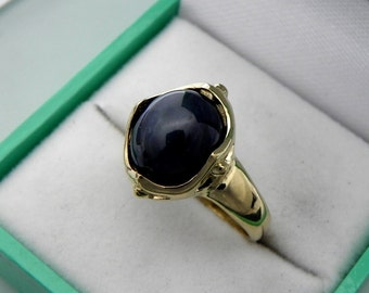 AAA Blue Star Sapphire Cabochon   12x10mm  7.42 Carats   in 14K Yellow gold ladies ring.  0807