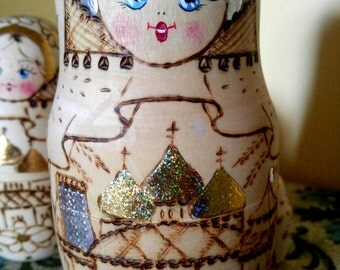 Gold and Silver Russian Hand Painted Nesting Doll