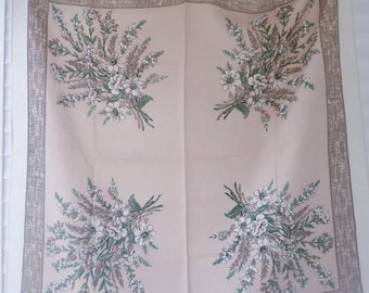 Vintage cotton tablecloth featuring muted bouquets