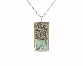 Tree branch pendant with ancient roman glass set in silver
