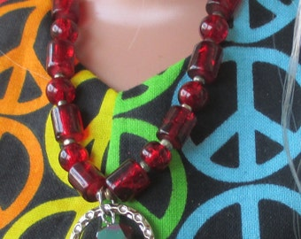 Barbie wearing a deep red necklace set.