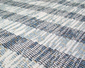 Hand loomed rag rug recycled post consumer goods
