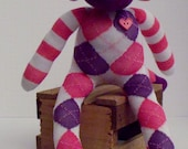 Sock Monkey Made From a Pink and Purple Argyle and Striped Sock and Adorned With Button Eyes and  Button Heart and a Hand Stitched Mouth