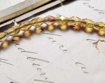 vintage Czech glass beads - tiny faceted barrels with AB Aurora Borealis finish - rainbow aura citrine - 5mm