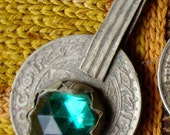 Moroccan gold colour and green glass jewel coin (B)