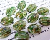 4 glass cabochons, 16x12mm, green white glitter, oval