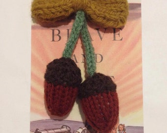 Hand knitted acorn brooch