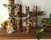 set of vintage mid century totem pole souvenirs. set of vintage totem pole souvenirs. vintage folk totem pole.