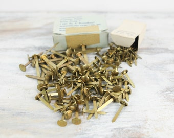 Vintage Brass Prong Paper Fasteners (174 count, various sizes).