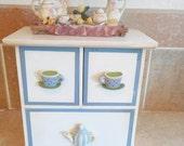little wood vintage dresser set  with cute mini girls tea set.