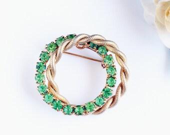 Vintage Rhinestone Brooch, Green rhinestone interwined circles pin, gold tone metal, rope circle, rhinestone circle